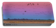 Geese Flying At Sunset Portable Battery Charger by Marc Crumpler