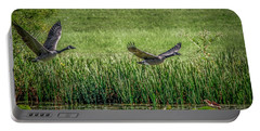 Portable Battery Charger featuring the photograph Geese In Flight by Ray Congrove