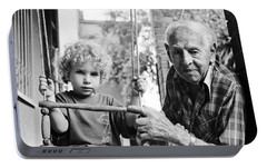 Portable Battery Charger featuring the photograph Generations by Dubi Roman