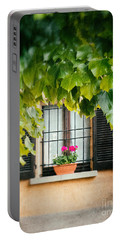 Portable Battery Charger featuring the photograph Geraniums On Windowsill by Silvia Ganora