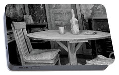 Portable Battery Charger featuring the photograph Ghost Town Table by Tom Singleton