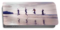 Girls Jumping On Lofoten Beach Portable Battery Charger by Tamara Sushko