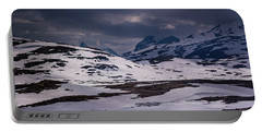 Portable Battery Charger featuring the photograph Gloomy Day On The Snow Road by Dmytro Korol