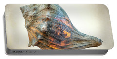 Portable Battery Charger featuring the photograph Glowing Conch Shell by Gary Slawsky