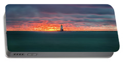 Glowing Sunset On Lake With Lighthouse Portable Battery Charger