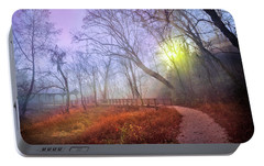 Portable Battery Charger featuring the photograph Glowing Through The Trees by Debra and Dave Vanderlaan
