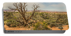 Gnarled Juniper Tree In Arches Portable Battery Charger by Sue Smith