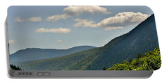 Portable Battery Charger featuring the photograph God's Country by Barbara S Nickerson