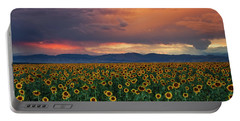 Portable Battery Charger featuring the photograph God's Sunflower Sky by John De Bord