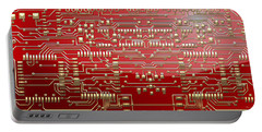 Gold Circuitry On Red Portable Battery Charger
