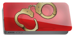 Gold Handcuffs On Red Portable Battery Charger