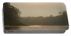 Golden Haze Covering The Amazon River Portable Battery Charger