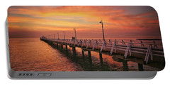 Golden Red Skies Over The Pier Portable Battery Charger