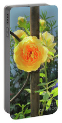 Portable Battery Charger featuring the photograph Golden Ruffled Rose On Iron Trellis by Nancy Lee Moran