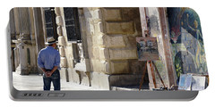 Portable Battery Charger featuring the photograph Granada Painter On The Plaza by Harvey Barrison