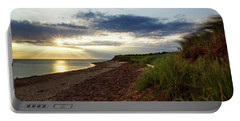 Portable Battery Charger featuring the photograph Grass Sways On Prince Edward Island Bluffs by Chris Bordeleau