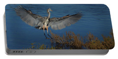 Great Blue Heron Landing Portable Battery Charger by Ernie Echols