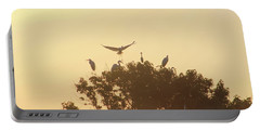 Great Egret Joining Friends Portable Battery Charger by Robert Banach