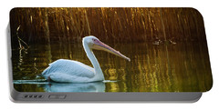 Great White Pelican Swimming On Lake Portable Battery Charger