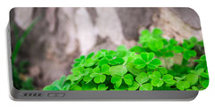 Green Clover And Grey Tree Portable Battery Charger by John Williams