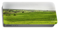 Portable Battery Charger featuring the photograph Green Fields. by Arik Baltinester