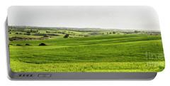 Green Fields. Portable Battery Charger by Arik Baltinester