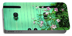 Green Gate With Flowers Portable Battery Charger by Stephanie Moore