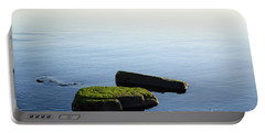 Portable Battery Charger featuring the photograph Green Rocks In Smooth Water by Kennerth and Birgitta Kullman