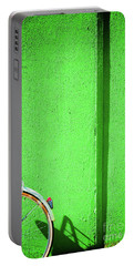 Portable Battery Charger featuring the photograph Green Wall And Bicycle Wheel by Silvia Ganora