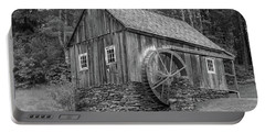 Portable Battery Charger featuring the photograph Grist Mill by Guy Whiteley