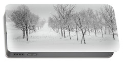 Grove Of Trees In A Snow Storm Portable Battery Charger
