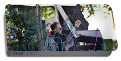 Portable Battery Charger featuring the photograph Guitarist In The Plaza Duquesa De Parcent by Harvey Barrison