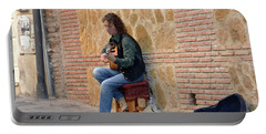 Portable Battery Charger featuring the photograph Guitarist On The Cuesta De Gomerez by Harvey Barrison