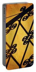 Portable Battery Charger featuring the photograph Gutter And Ornate Shadows by Silvia Ganora