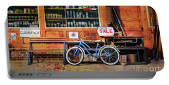 Portable Battery Charger featuring the photograph Half Off Sale Bicycle by Craig J Satterlee