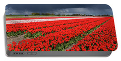Half Side Red Tulips Field Portable Battery Charger by Mihaela Pater