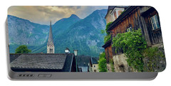 Portable Battery Charger featuring the photograph Hallstatt Village Stroll by Jacqueline Faust