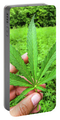 Hand Holding A Hemp Leaf Portable Battery Charger