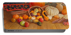 Portable Battery Charger featuring the painting Harvest Bounty by Nancy Lee Moran