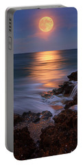 Harvest Moon Rising Over Beach Rocks On Hutchinson Island Florida During Twilight. Portable Battery Charger by Justin Kelefas