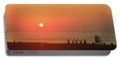 Portable Battery Charger featuring the photograph Headstand Fun At Sunrise by Robert Banach