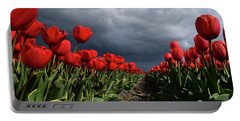 Heavy Clouds Over Red Tulips Portable Battery Charger by Mihaela Pater