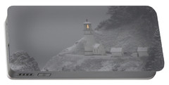 Heceta Lighthouse Snowstorm Portable Battery Charger by Kenny Henson