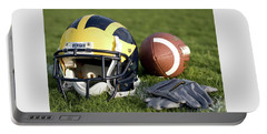 Helmet On The Field With Football And Gloves Portable Battery Charger