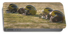 Helmets In Golden Dawn Sunlight Portable Battery Charger