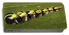Helmets Of Different Eras On The Field Portable Battery Charger