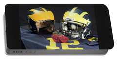 Helmets Of Different Eras With Jersey And Roses Portable Battery Charger