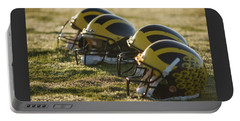 Helmets On The Field At Dawn Portable Battery Charger