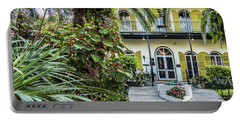 Portable Battery Charger featuring the photograph Hemingway House - Key West by Bob Slitzan