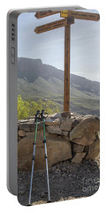 Hiking Poles Resting Near Sign Portable Battery Charger by Patricia Hofmeester